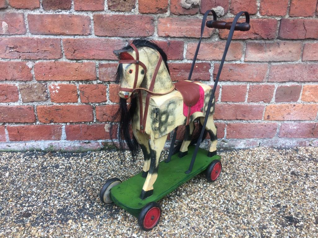 antique push along toy horse
